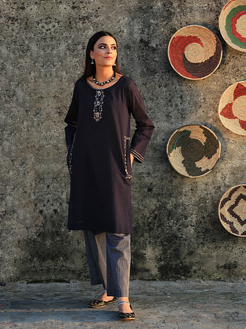 A-very-trendy-navy-blue-shirt-paired-with-striped-pants.-Hand-embroidered-with-thread,-sheeha-and-patti.-2